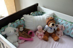 stuffed animals in crib